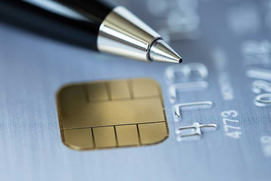 Plasma Treatment of Plastic Card & Loyalty Cards - a close up view of a credit card and pen